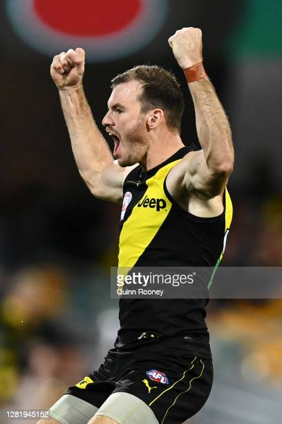 Kamdyn McIntosh of the Tigers celebrates kicking a goal during the 2020 AFL Grand Final match between the Richmond Tigers and the Geelong Cats at The...