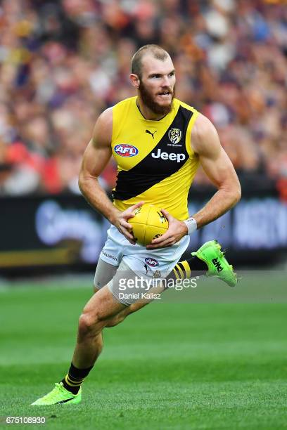 Kamdyn McIntosh of the Tigers looks to pass the ball during the round six AFL match between the Adelaide Crows and the Richmond Tigers at Adelaide...