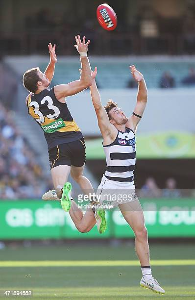 Kamdyn McIntosh of the Tigers marks the ball over Jordan Murdoch of the Cats during the round five AFL match between the Richmond Tigers and the...