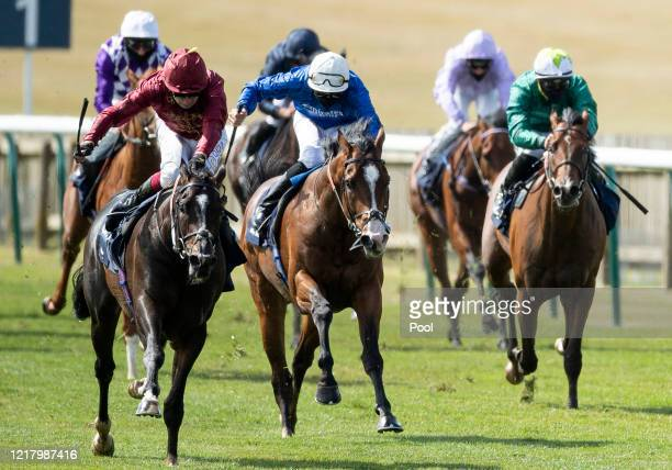 Kameko ridden Oisin Murphy approaches the finish line to win the Qipco 2000 Guineas Stakes at Newmarket Racecourse on June 06 2020 in Newmarket...