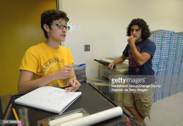 Kameko Rios left and Ivan Ramirez keep track of the progress of plants in the aquaponics lab at Millikan High School in Long Beach on MondayHigh...