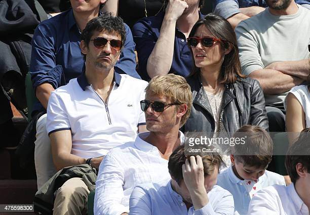 Kamel Belghazi and his girlfriend Marine attend day 9 of the French Open 2015 at Roland Garros stadium on June 1 2015 in Paris France