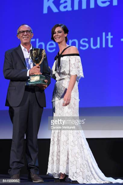 Kamel El Basha receives the Coppa Volpi for Best Actor Award for The Insult from 'Venezia 74' jury member Anna Mouglalis during the Award Ceremony of...