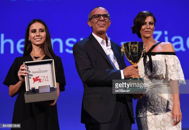 Kamel El Basha receives the Coppa Volpi for Best Actor Award for The Insult from 'Venezia 74' jury member Anna Mouglalis with a JaegerLeCoultre...