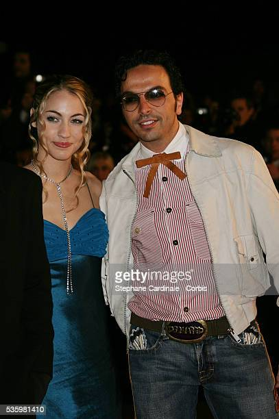 Kamel Ouali and date arriving at the Cannes festival palace to attend the NRJ Music Awards
