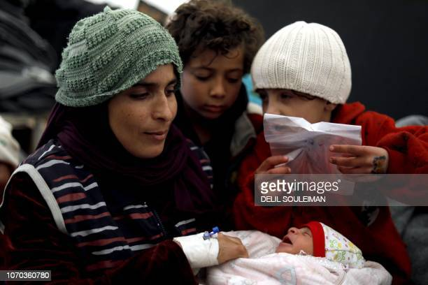 Kamela Fadel a displaced Syrian woman from the locality of alShaafa holds her newborn Faraj in her arms at the Internallly Displaced Persons camp of...