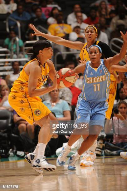 Kamela Gissendanner of the Los Angeles Sparks passes the ball during the game against Jia Perkins of the Chicago Sky on June 18 2008 at Staples...