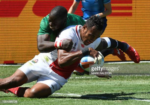 Kameli Soejima of Japan scores a try as Jeffrey Oluoch of Kenya tackles in their Championship semifinal game at the Rugby Sevens World Cup in the ATT...