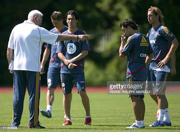 Head coach Luis Aragones gives instructions to forward Luis Garcia midfielder Xavi Hernandez and defender Sergio Ramos during the Spanish football...