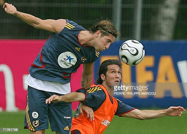 Spanish defender Sergio Ramos and midfielder Luis Garcia fight for the ball during a training session in Kamen 25 June 2006 Spain will play their...