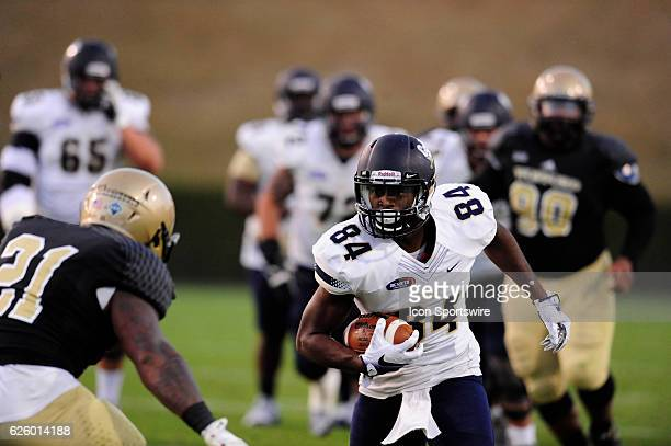 Kameron Brown wide receiver Charleston Southern University Buccaneers runs for yardage after a catch against the Wofford College Terriers in the...
