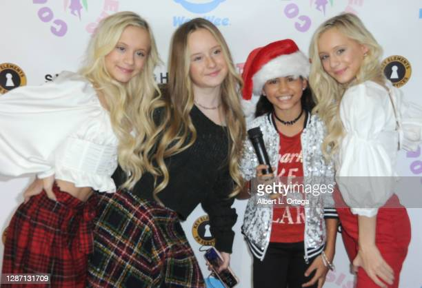 Kameron Couch, Mackenzie Couch, Madison Taylor Baez and Katie Couch participate in the 2nd Annual Toys For Tots Toy Drive held at The Industry Loft...