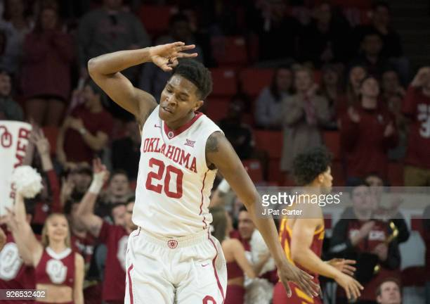 Kameron McGusty of the Oklahoma Sooners celebrates after scoring against Iowa State during the first half of a NCAA college basketball game at the...