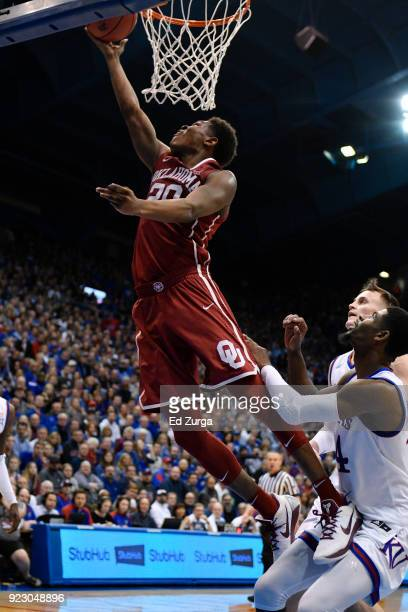Kameron McGusty of the Oklahoma Sooners lays the ball up against the Kansas Jayhawks at Allen Fieldhouse on February 19 2018 in Lawrence Kansas