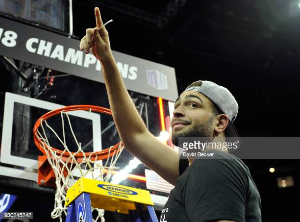 Kameron Rooks of the San Diego State Aztecs displays a piece of the net after the team defeated the New Mexico Lobos in the championship game of the...