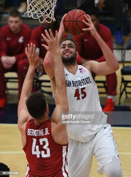 Kameron Rooks of the San Diego State Aztecs takes a shot over Drick Bernstine of the Washington State Cougars the championship game of the Wooden...