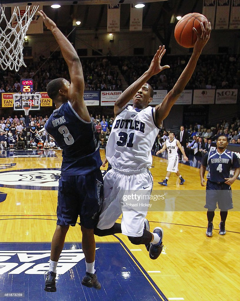 Kameron Woods #31 of the Butler Bulldogs shoots the ball against Mikael Hopkins #3 of the Georgetown Hoyas at Hinkle Fieldhouse on January 11, 2014 in Indianapolis, Indiana. Georgetown defeated Butler 70-67.