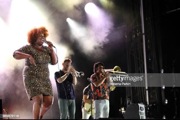 Kamerra Franklin Jon Durbin and Michael Razo of The Suffers perform during the 2018 Festival International de Jazz de Montreal at Quartier des...