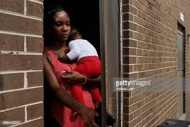 Kamia Edwards holds her son Darrell Jackson as she poses for a portrait inside her apartment at the West Calumet Housing Complex on September 4 2016...
