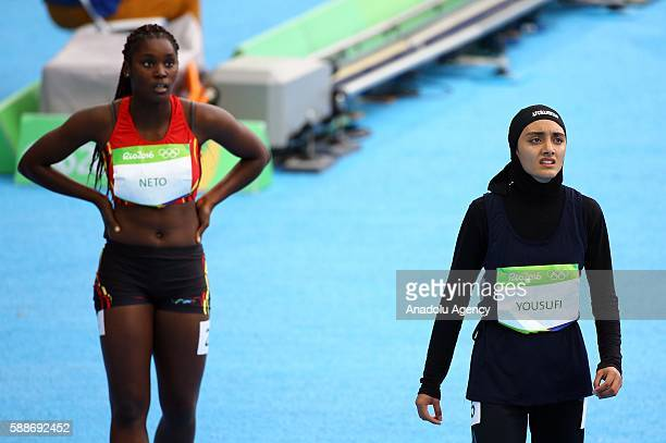 Kamia Yousufi of Afghanistan reacts after the Women's 100 metres preliminary on Day 7 of the Rio 2016 Olympic Games at the Olympic Stadium in Rio de...