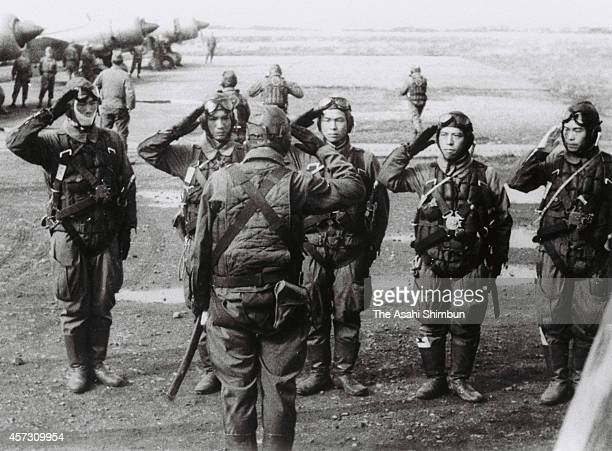 Kamikaze pilots of Sekicho Hikotai of Imperial Japanese Army salute prior to the battle of Leyte Gulf on December 5, 1944 in the Philippines.