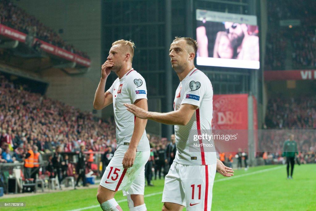 Kamil Glik and Kamil Grosicki of Poland dejected during the FIFA World Cup 2018 Qualifying Round between Denmark and Poland at Telia Parken Stadium in Copenhagen, Denmark on September 1, 2017