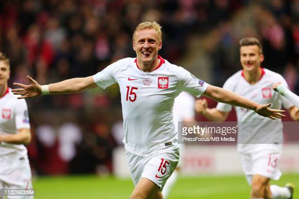 Kamil Glik celebrates scoring a goal during the 2020 UEFA European Championships group G qualifying match between Poland and Latvia at National...
