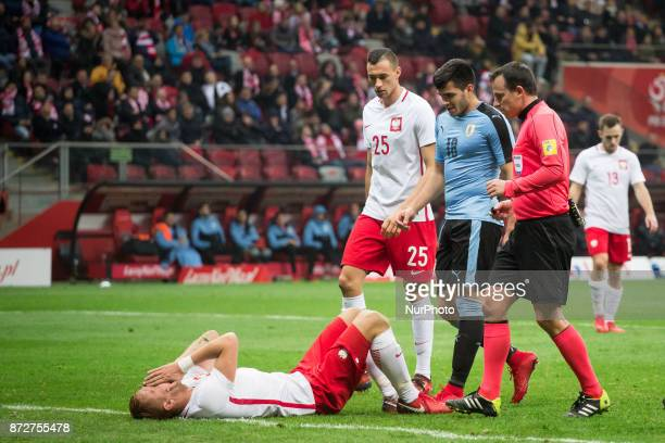 Kamil Glik Jaroslaw Jach Maximiliano Gomez and referee Istvan Vad during the international friendly soccer match between Poland and Uruguay at the...