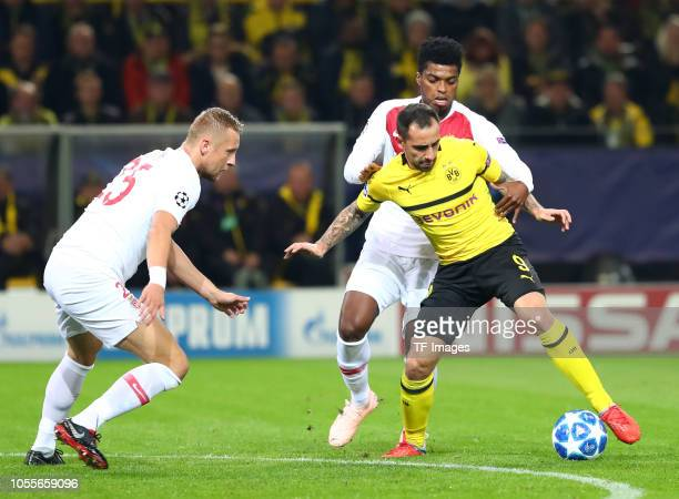Kamil Glik of AS Monaco and Jemerson de Jesus Nascimento of AS Monaco and Paco Alcacer of Borussia Dortmund battle for the ball during the Group A...