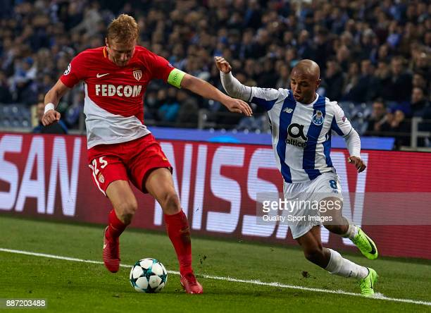 Kamil Glik of AS Monaco is challenged by Yacine Brahimi of FC Porto during the UEFA Champions League group G match between FC Porto and AS Monaco at...