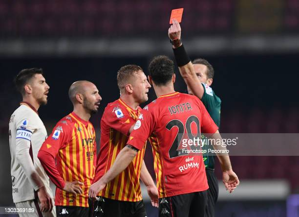 Kamil Glik of Benevento Calcio is shown a red card by Referee Luca Pairetto during the Serie A match between Benevento Calcio and AS Roma at Stadio...