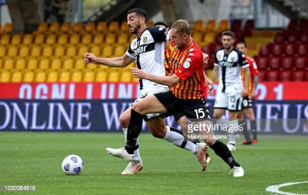 Kamil Glik of Benevento competes for the ball with Graziano Pellè of Parma during the Serie A match between Benevento Calcio and Parma Calcio at...