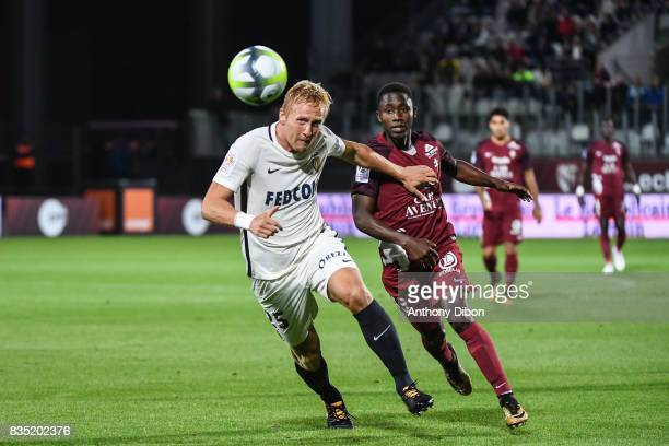 Kamil Glik of Monaco and Ablie Jallow of Metz during the Ligue 1 match between FC Metz and AS Monaco on August 18 2017 in Metz