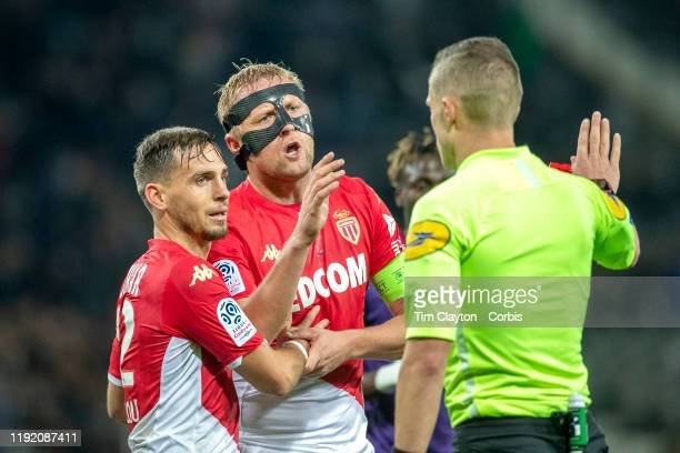 Kamil Glik of Monaco argues a penalty decision given against his side by referee Willy Delajod as Ruben Aguilar of Monaco attempts to intervene...