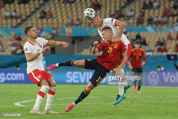 Kamil Glik of Poland competes for a header with whilst under pressure from Dani Olmo of Spain during the UEFA Euro 2020 Championship Group E match...