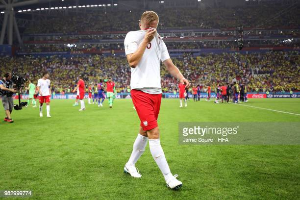 Kamil Glik of Poland looks dejected following his sides defeat in the 2018 FIFA World Cup Russia group H match between Poland and Colombia at Kazan...