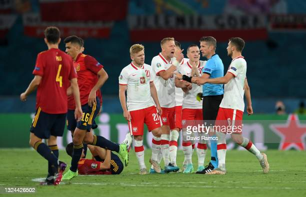 Kamil Glik of Poland protests to Match Referee, Daniele Orsato after team mate Kamil Jozwiak is shown a yellow card during the UEFA Euro 2020...