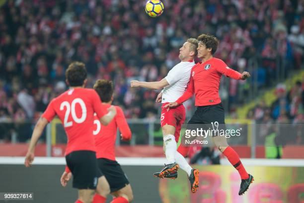 Kamil Glik of Poland vies Jeongho Hong during the international friendly soccer match between Poland and South Korea national football teams at the...