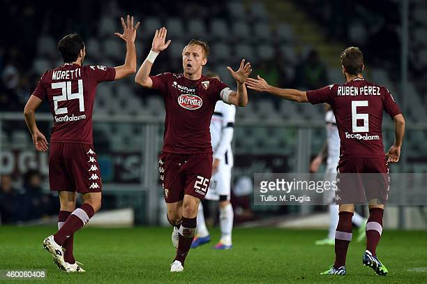 Kamil Glik of Torino celebrates with team mates after scoring the second equalizing goal during the Serie A match between Torino FC and US Citta di...