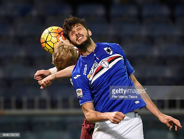 Kamil Glik of Torino FC competes for the ball with Andrea Ranocchia of UC Sampdoria during the Serie A match between UC Sampdoria and Torino FC at...