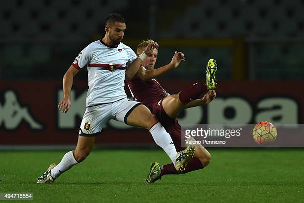 Kamil Glik of Torino FC is tackled by Leonardo Pavoletti of Genoa CFC during the Serie A match between Torino FC and Genoa CFC at Stadio Olimpico di...