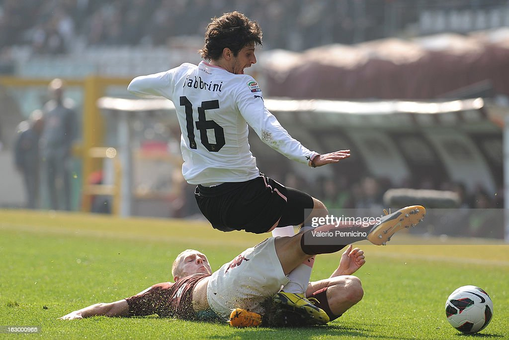 Kamil Glik of Torino FC tackles Diego Fabbrini of US Citta di Palermo during the Serie A match between Torino FC and US Citta di Palermo at Stadio Olimpico di Torino on March 3, 2013 in Turin, Italy.