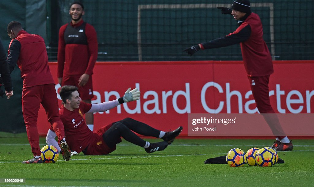 Kamil Grabara and Joel Matip of Liverpool during a training session at Melwood Training Ground on December 28, 2017 in Liverpool, England.