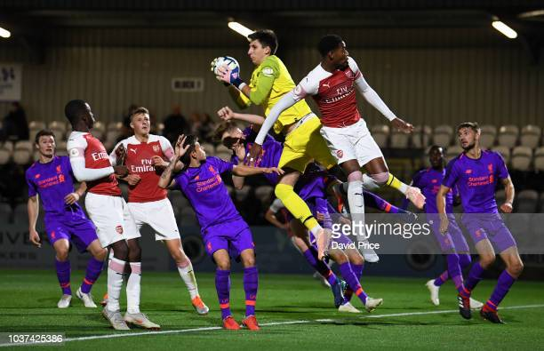 Kamil Grabara of Liverpool catches the ball under pressure from Zech Medley of Arsenal during the match between Arsenal U23 and Liverpool U23 at...