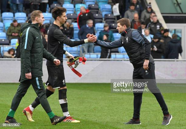 Kamil Grabara of Liverpool with Liverpool U18 manager Steven Gerrard at the end of the Manchester City v Liverpool UEFA Youth League game at...