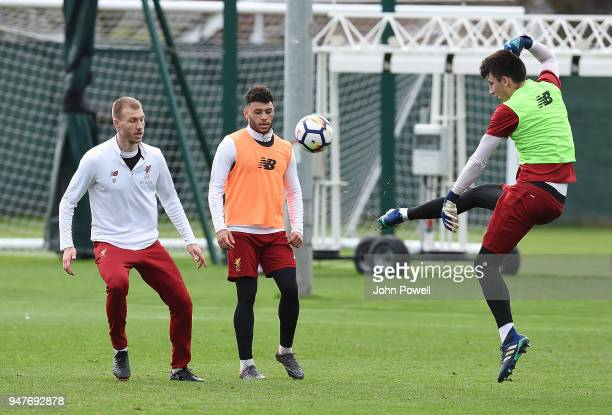 Kamil Grabara with Alex OxladeChamberlain and Ragnar Klavan of Liverpool during a training session at Melwood Training Ground on April 17 2018 in...