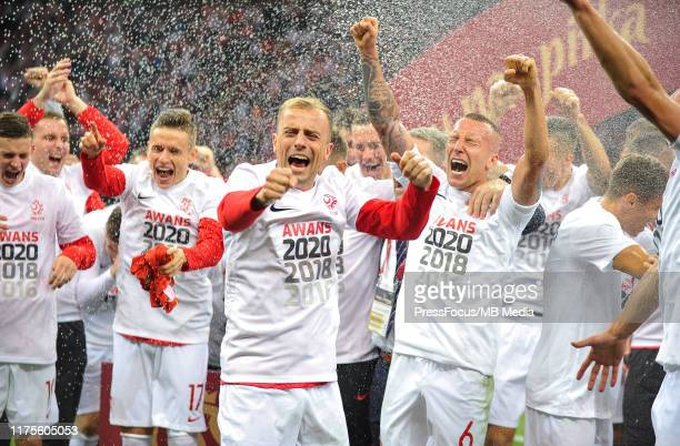 Kamil Grosicki and Jacek Goralski celebrate qualifying to Euro 2020 after the UEFA Euro 2020 qualifier between Poland and North Macedonia on October...