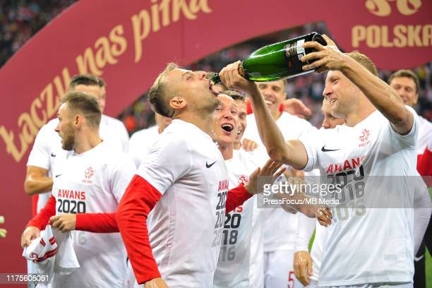 Kamil Grosicki and Kamil Glik celebrate qualifying to Euro 2020 after the UEFA Euro 2020 qualifier between Poland and North Macedonia on October 13...