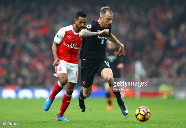Kamil Grosicki of Hull City and Theo Walcott of Arsenal compete for the ball during the Premier League match between Arsenal and Hull City at...