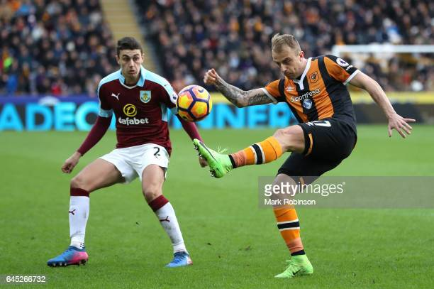 Kamil Grosicki of Hull City clears the ball while under pressure from Matthew Lowton of Burnley during the Premier League match between Hull City and...